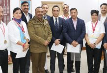 Meritorious JKP shuttlers posing along with DGP Dilbag Singh during felicitation function in Jammu on Monday.