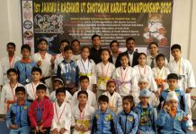 Karatekas posing for a group photograph along with dignitaries and officials in Jammu.