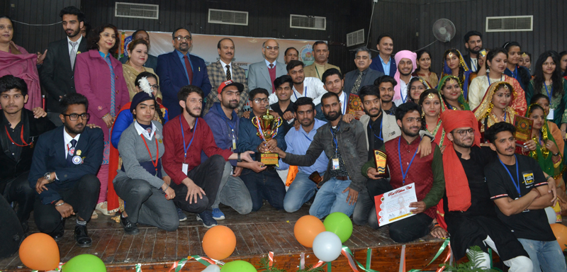 Advisor K K Sharma posing with JU team at conclusion of National Integration camp on Friday.