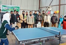 Players in action during Table Tennis match of Rolling Championship in Shopian.