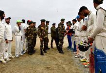 Chief guest interacting with the teams during inaugural function of cricket tournament organised by Army in Ganderbal.