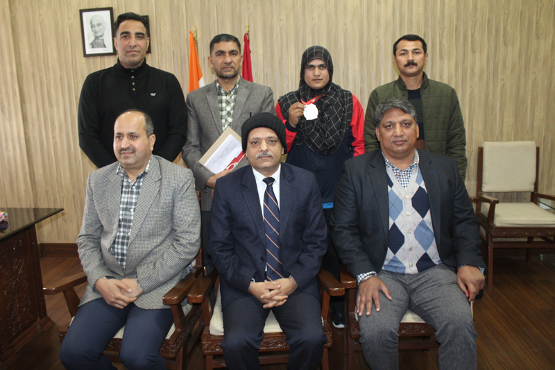 Medal winner Wushu player Khalida Bano posing for a group photograph with ADGP Armed J&K and Senior Officers of APHQ during felicitation ceremony.