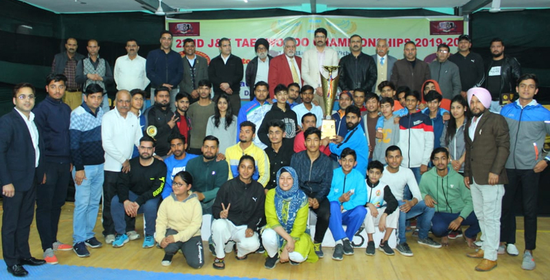 Winners of Taekwondo Championship posing along with chief guest Rayees Mohd Bhatt and other dignitaries in Jammu on Saturday.