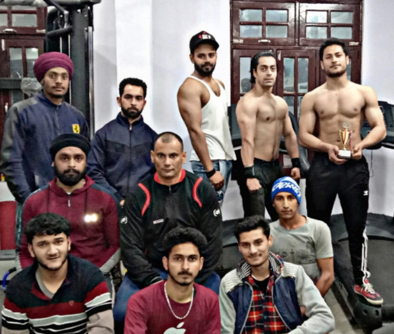 Winners of power lifting competition posing for a group photograph.
