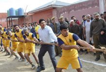 Jail inmates in action during Tug of War match at Pulwama.