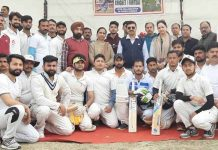 Young cricketers posing along with DC Samba, Rohit Khajuria and other dignitaries during inaugural ceremony of Inter-Panchayat Cricket Tournament.