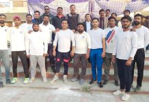 Players of Evengical church team posing alongwith officials in Jammu on Monday.