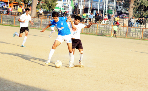 Footballers in action during a match of 27th Annual Football Championship in Jammu.