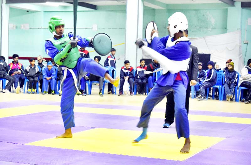 Players in action during 65th National School Games in Sqay Martial at JU on Saturday.