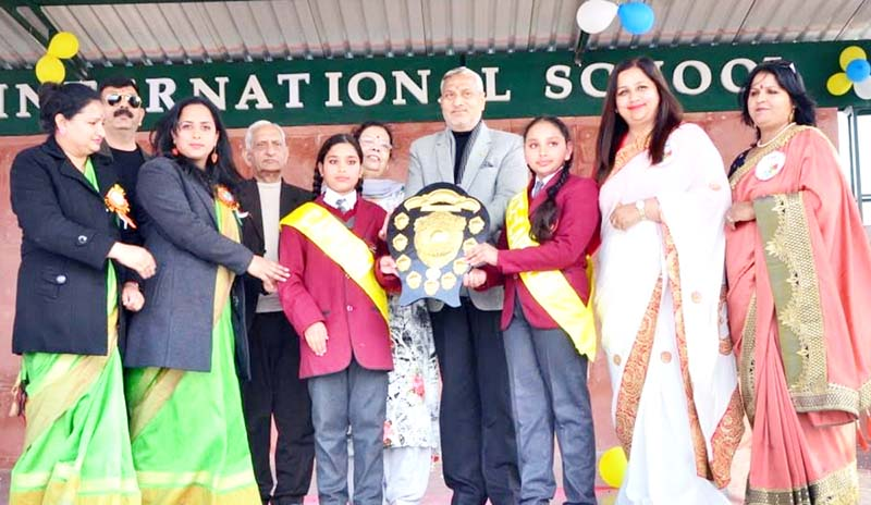 Former minister and BJP leader, Sham Lal Sharma felicitating students with trophy during the annual function in Jammu.
