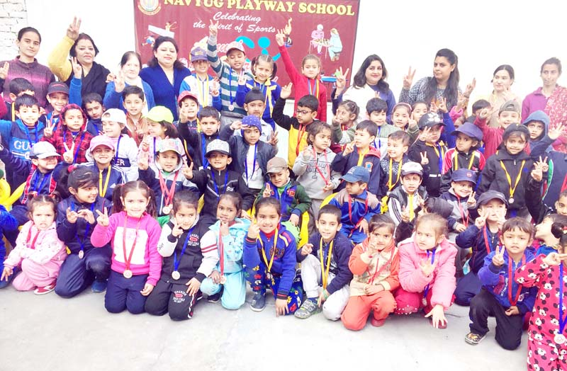 Winners posing along with dignitaries and officials during Sports Day at Nuvyug Play Way School in Jammu.