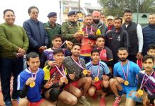 Winners of Udhampur Club receiving title trophy from chief guest at Mini Stadium, Udhampur.