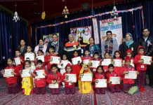 Students displaying prizes during Foundation Day celebration at Pushp Vatika in Jammu.