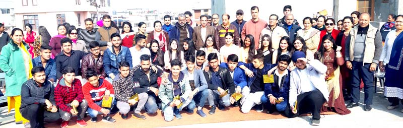 Students posing along with staff members during Annual Day celebration at GHSS Camp Bohri in Jammu.