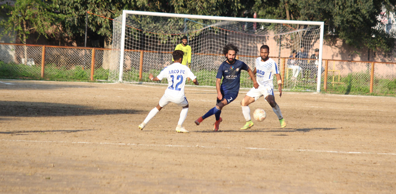 Players in action during a football match of 27th Annual Football Championship in Jammu on Friday. —Excelsior/Rakesh