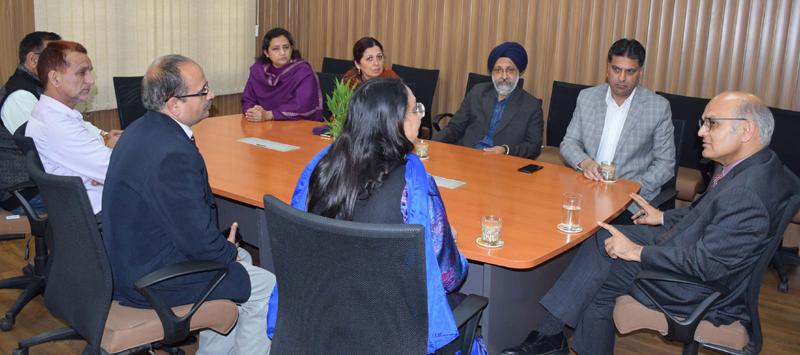 Advisor K K Sharma chairing a meeting on Tuesday.