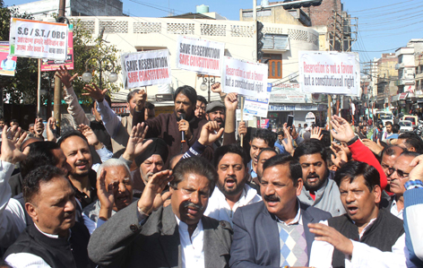 Cong leaders and activists staging protest demonstration against BJP Govt in Jammu on Saturday. -Excelsior/Rakesh
