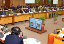 Lt Governor G C Murmu chairing a meeting at Udhampur.