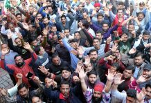 PHE workers staging protest outside Chief Engineer's office at BC Road in Jammu on Saturday. -Excelsior/Rakesh