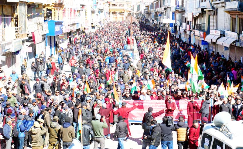 People taking out rally in Leh on Monday. -Excelsior/Morup Stanzin