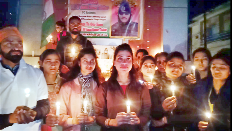 People lit candles to pay tributes to martyr DySP Aman Kumar Thakur at Doda.