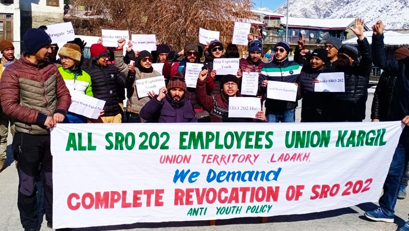 Employees taking out protest march at Kargil for revocation of SRO-202. -Excelsior/Basharat Ladakhi