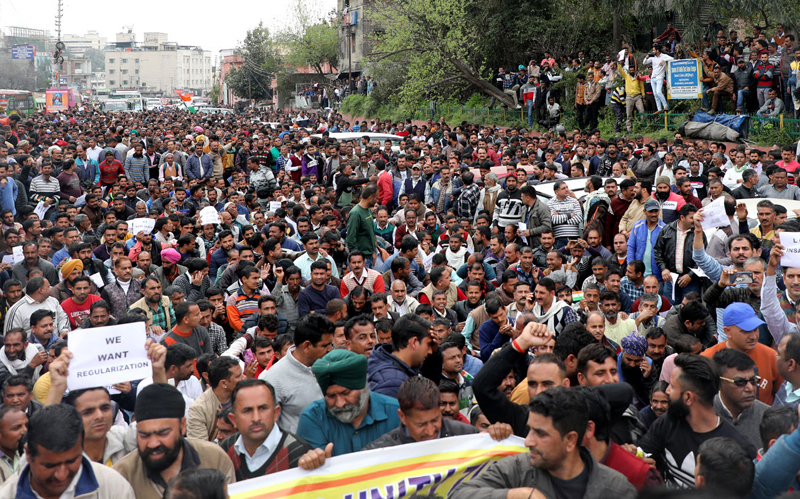 PHE workers taking out massive protest march to Civil Secretariat in Jammu on Wednesday. —Excelsior/Rakesh