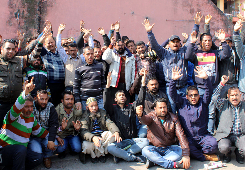 PHE employees staging protest in Jammu on Sunday. -Excelsior/Rakesh
