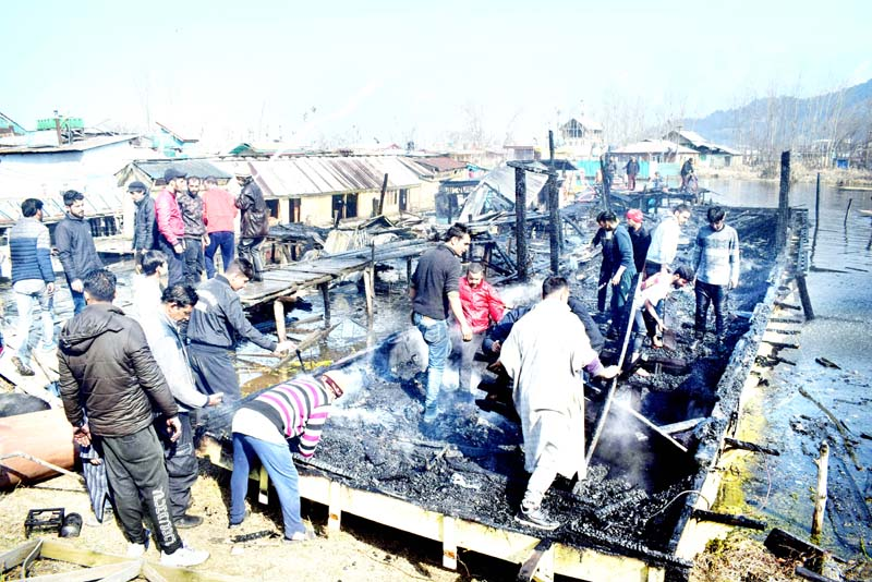 Houseboats damaged in fire incident at Konikhan in Dal Lake area. -Excelsior/Shakeel