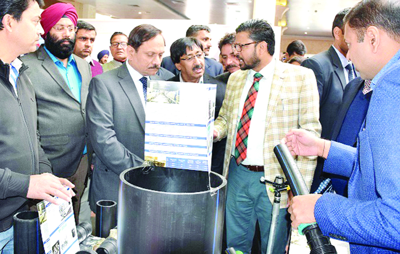Advisor R R Bhatnagar inspecting stalls during a conference in Jammu on Saturday.