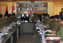 Advisor R R Bhatnagar and DGP Dilbag Singh chairing security review meeting at Anantnag.