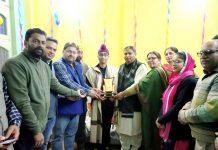 Ex-MLA Sat Sharma felicitating 8th standard student Onkar Singh who was awarded with Rashtriya Bal Shakti Puraskar.