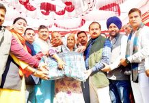 MP Jugal Kishore & BJP leaders distributing blankets among needy people in Bishnah.
