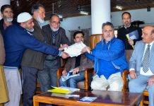 Asgar Samoon and Sheikh Fayaz interacting with a delegation.