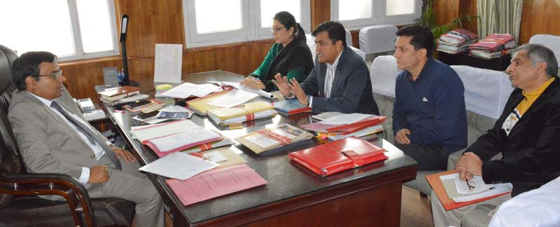 Industries Secretary chairing a meeting on Thursday.