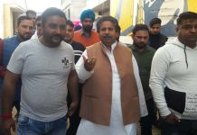 Congress leader Raman Bhalla interacting with farmers on Tuesday.