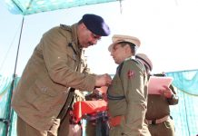 DGP Dilbag Singh presenting medal to a police cop in Kishtwar.