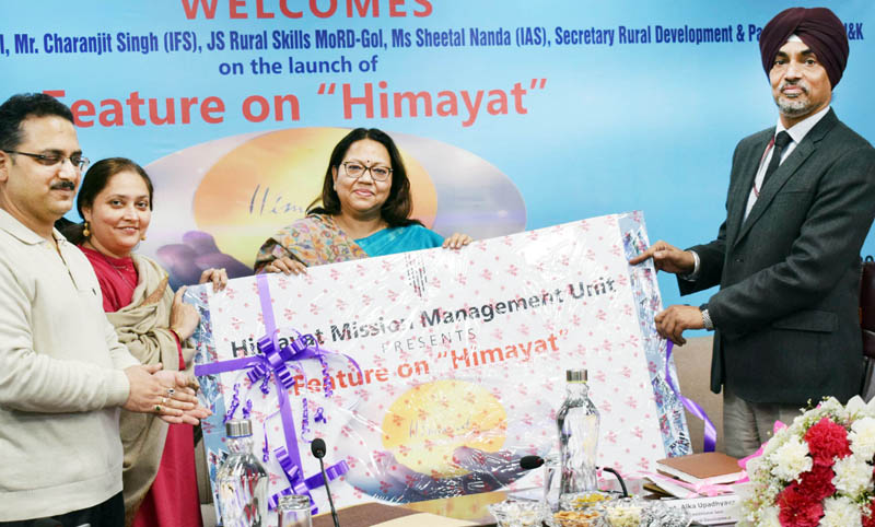 Additional Secretary Ministry of Rural Development Alka Upadhyaya releasing 'Himayat Feature'.