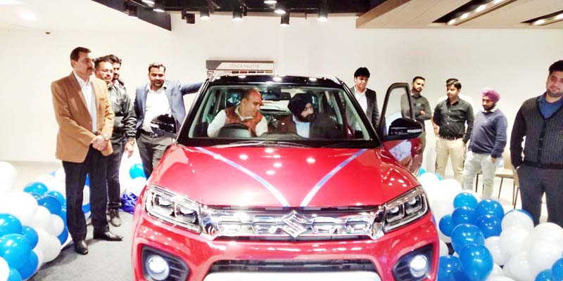Officials of Jammu Motors Private Limited, Bank Managers and others during launch of 'Vitara Brezza'.