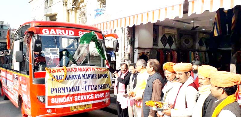 Mubarak Singh, president, J&K Dharmarth Trust flagging off 'Jammu Darshan' bus service from Raghunath Temple, Jammu.