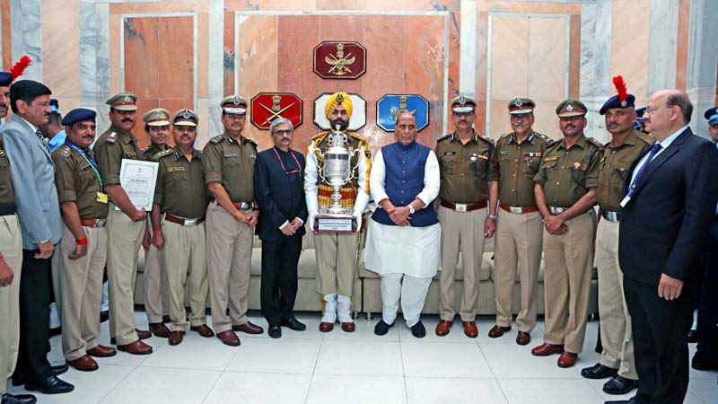 Defence Minister Rajnath Singh with the officers of Central Industrial Security Force (CISF) that was awarded the best marching contingent among Central Armed Police Forces, in New Delhi on Monday. (UNI)