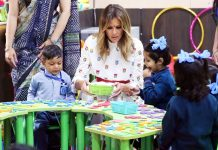 U.S. First Lady Melania Trump participates in an activity with children in an activity room at Sarvodaya Co-Educational Senior Secondary School in New Delhi on Tuesday.