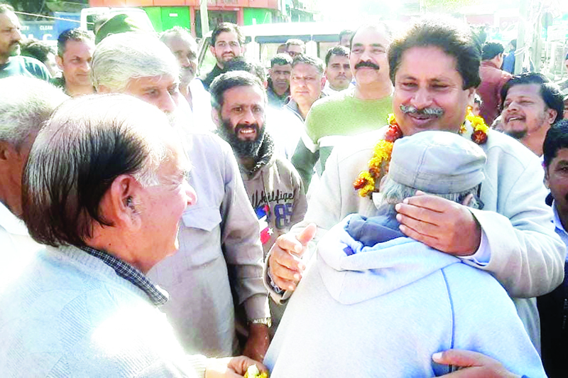 PCC vice president Raman Bhalla interacting with people at Bahu Fort on Tuesday.