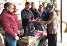 Chairman DLSA Rajouri, Jaffer Hussain Beg presenting clothes to a girl of Nari Niketan, Rajouri.