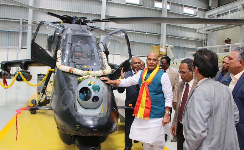 Defence Minister Rajnath Singh visiting the Hindustan Aeronautics Limited Complex in Bengaluru on Thursday. (UNI)
