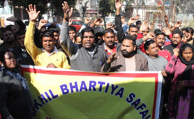 Safai Karamcharis protesting at Jammu on Friday. -Excelsior/Rakesh