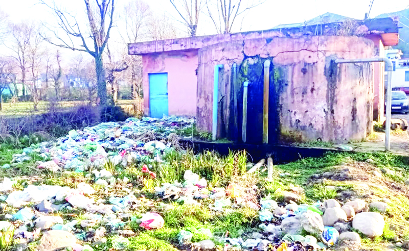 Garbage accumulated around drinking water tank in Revenue Colony of Mendhar in District Poonch. Excelsior/Rahi Kapoor