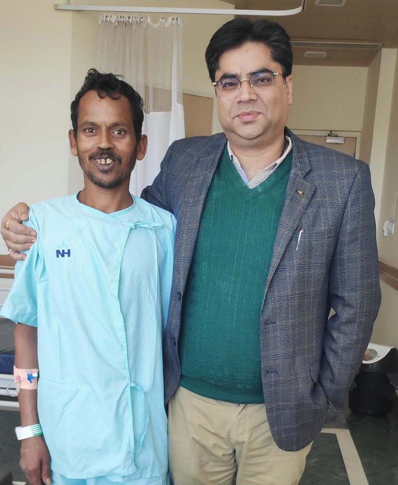 Dr Vikas Padha, Senior Consultant Orthopaedics and Joint Replacement, SMVDNSH, posing with the labourer on whom he operated successfully with Total Hip Replacement Surgery.