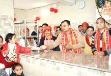 CEO SMVDSB Ramesh Kumar serving Prasad to pilgrims after inaugurating Prasad Sewa at Sanjichhat on Friday.