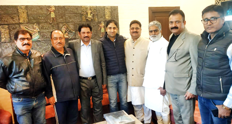 Prominent KPs and leaders of other organisations from Jammu with SMC Mayor, Junaid Mattoo on Friday.